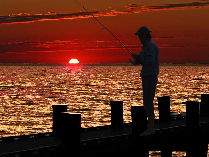 A fisherman at dawn along the Chesapeake Bay.
